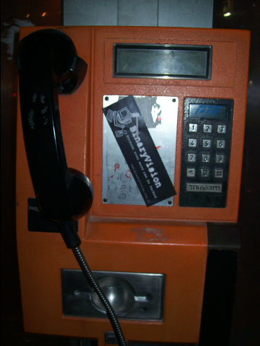 BinaryVision's Sticker on a Payphone!